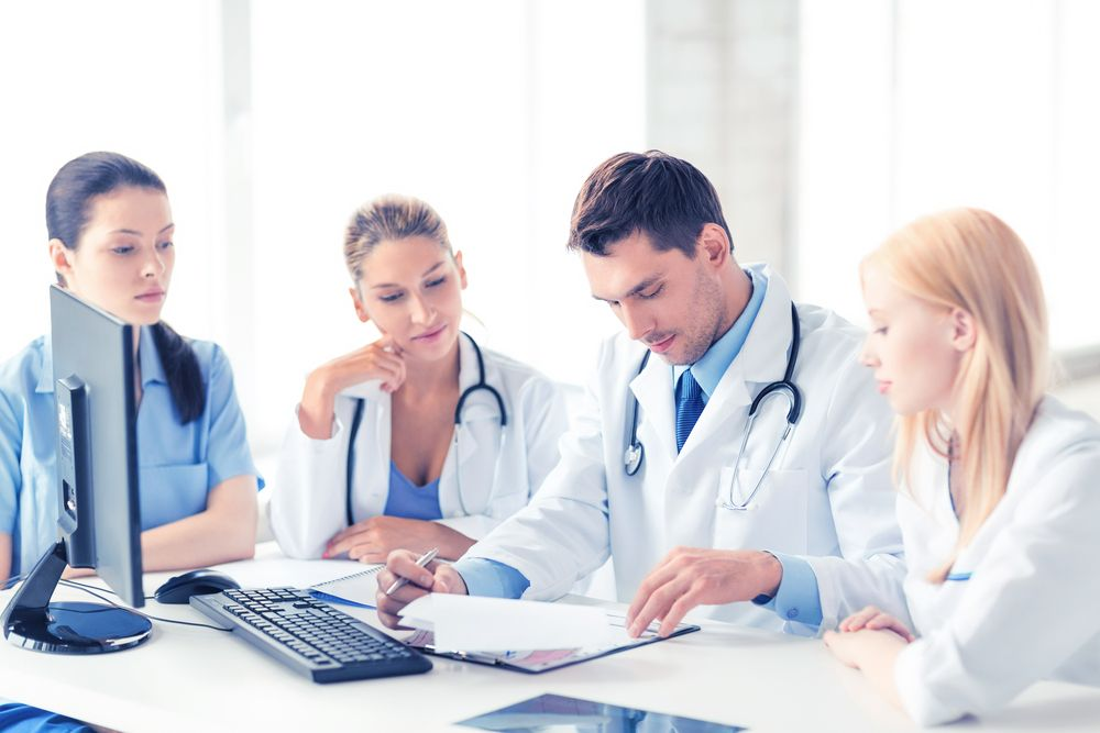 Diagnosing CMT   Charcot-Marie-Tooth News   doctors reviewing patient information